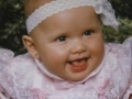 Stephanie at six months old. She was always a happy baby.